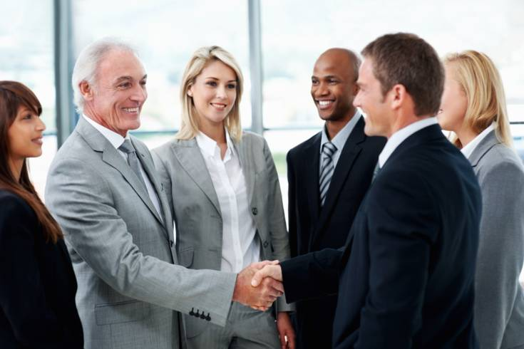 Sales and Support - Men shaking hands