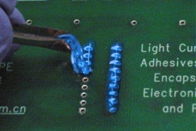 Dymax 9-20479-B-REV-A Blue PCB Protective Maskant applied to a PCB