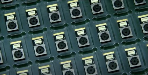 Assembly line of camera modules using Dymax 9803 adhesive